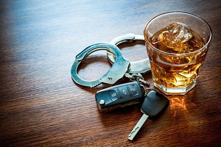 car keys with glass of alcohol